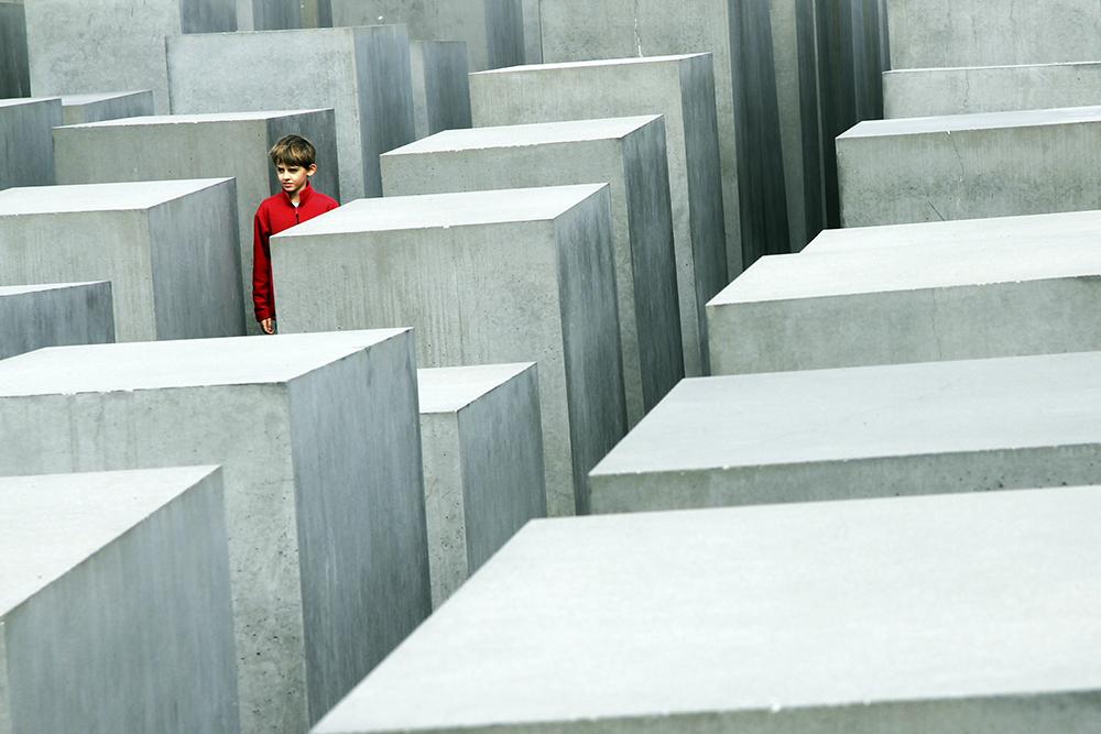 a boy in holocaust memorial in berlin